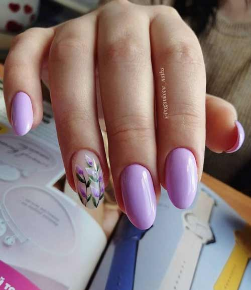 Lilac manicure with flowers