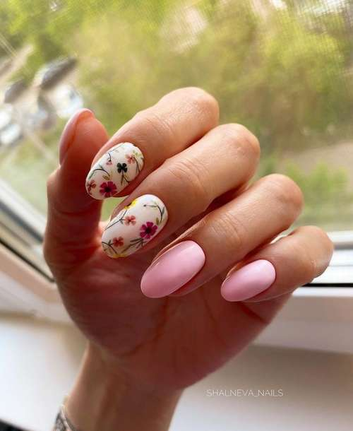 Manicure in pink tones with a floral print