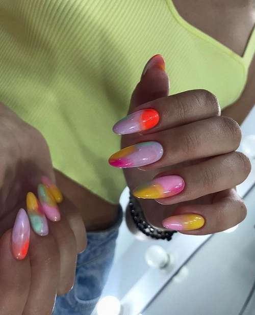 Multi-colored manicure with a pink tone