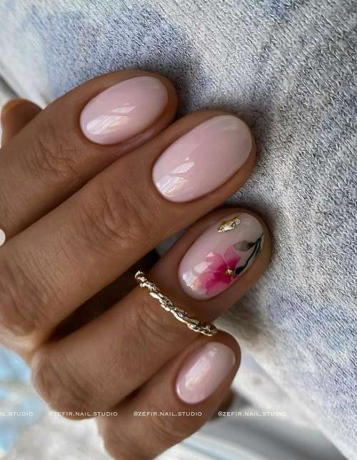 Pink manicure with a flower to match