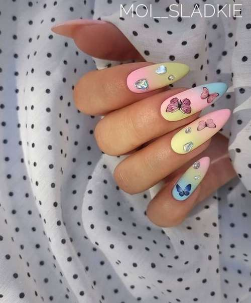 Delicate manicure with butterflies