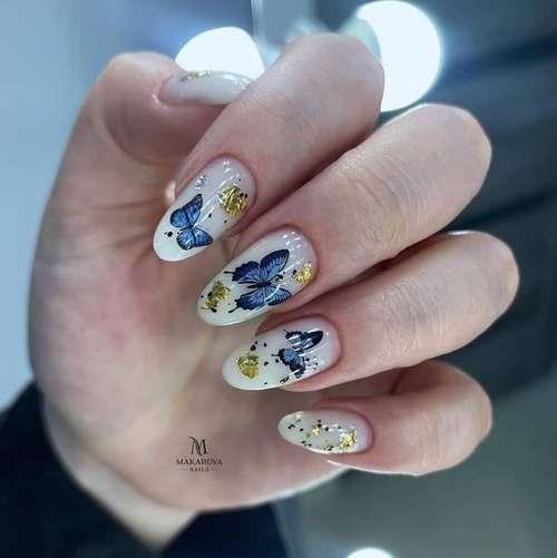 Milk manicure with butterflies
