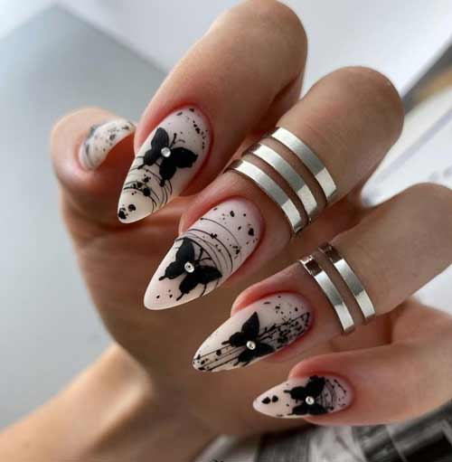 Butterfly manicure with rhinestones
