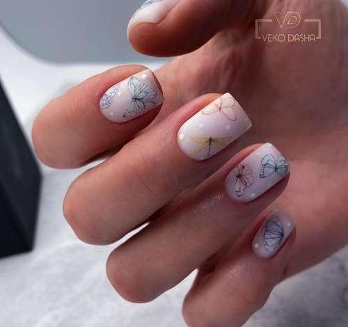 Beige manicure with butterflies