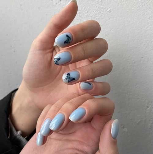 Black butterflies on short nails