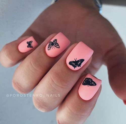 Pink manicure with a butterfly