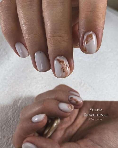 Delicate milk manicure with foil