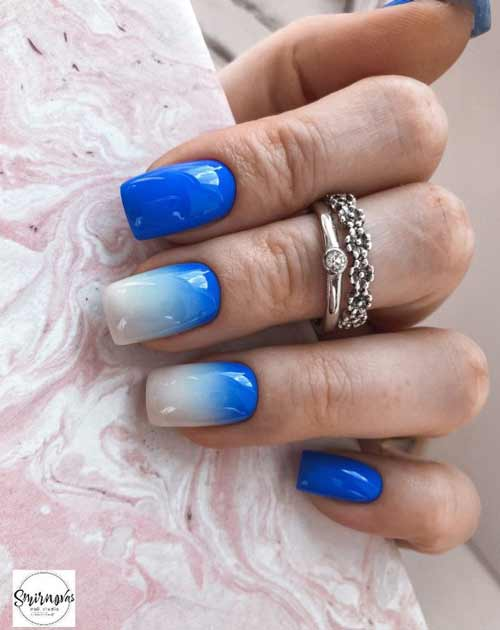 Milky with blue gradient on the nails