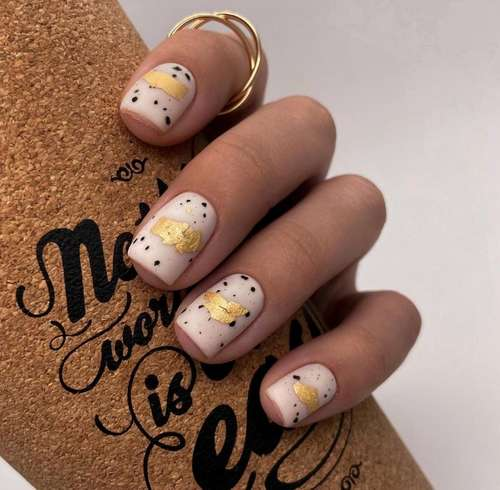 Matte manicure with speckles and foil