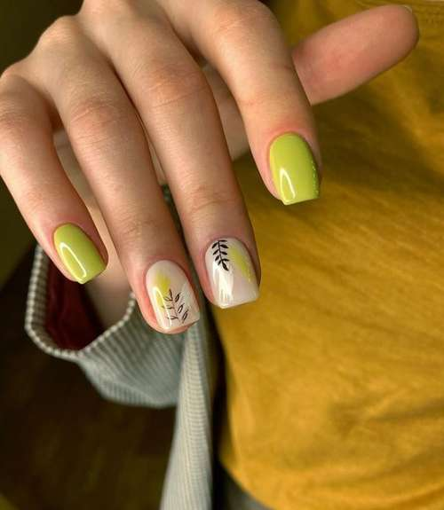 Green manicure with a twig