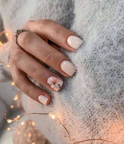 Beige manicure with a flower