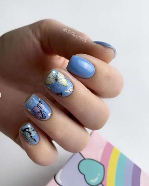 Blue manicure with butterfly