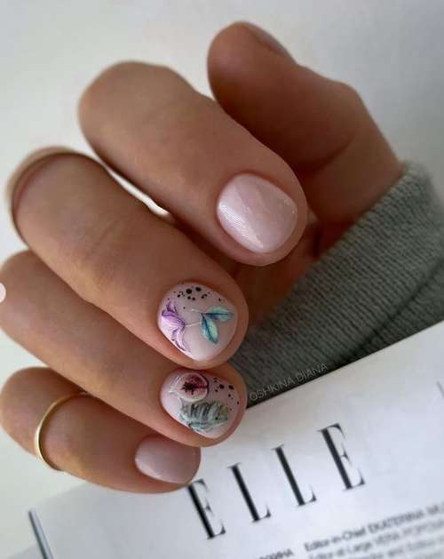 Multicolored butterflies on the nails
