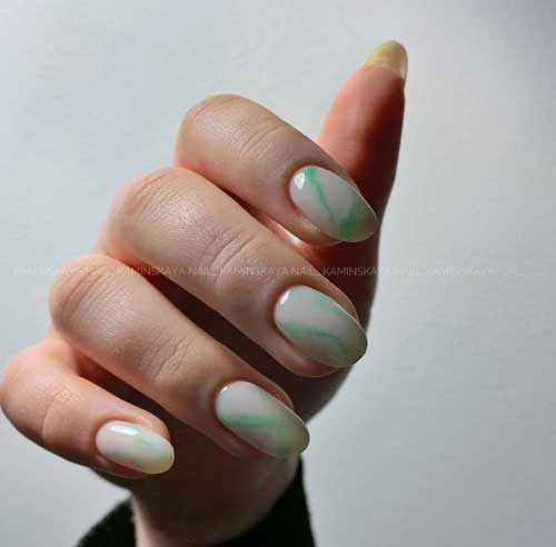 Pastel manicure with stains