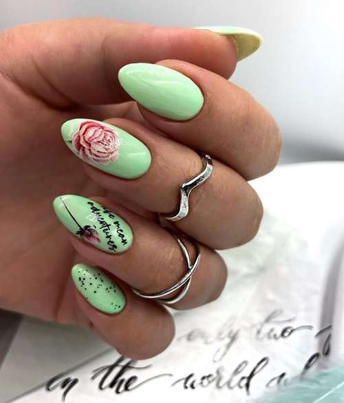 Green manicure with dots
