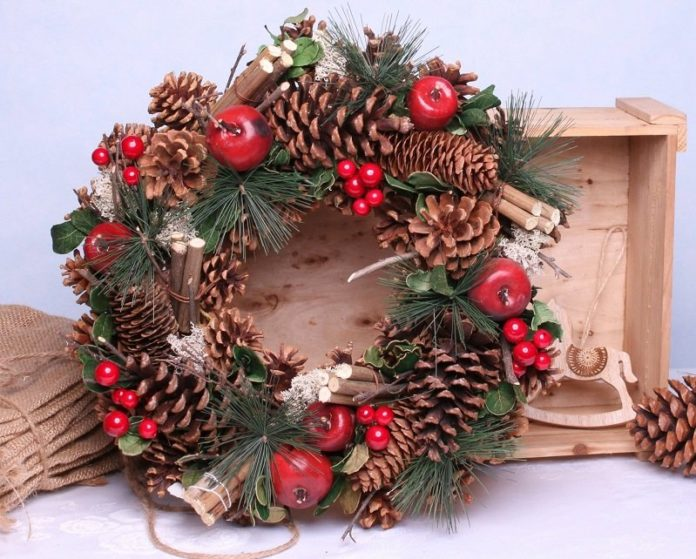 Wonderful New Year wreaths 2022, Christmas wreaths, wreaths on the table, under the candles photo