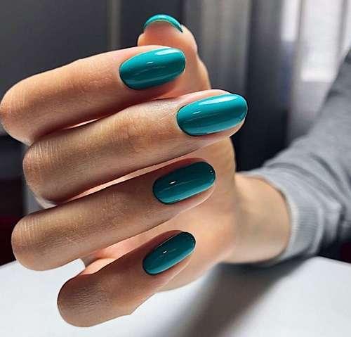 Plain turquoise manicure photo