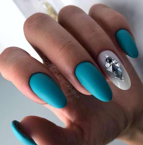 Matte turquoise rhinestones manicure