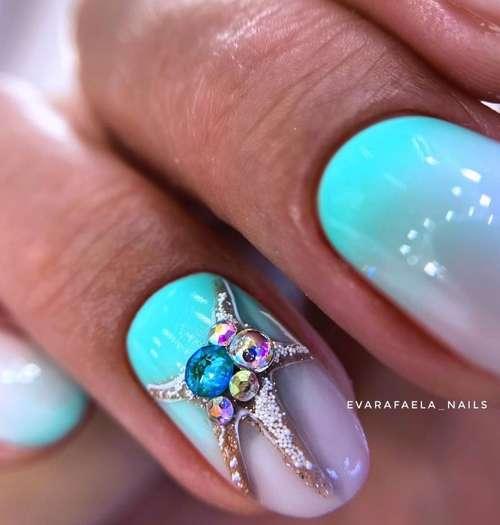 Marine manicure turquoise and rhinestones