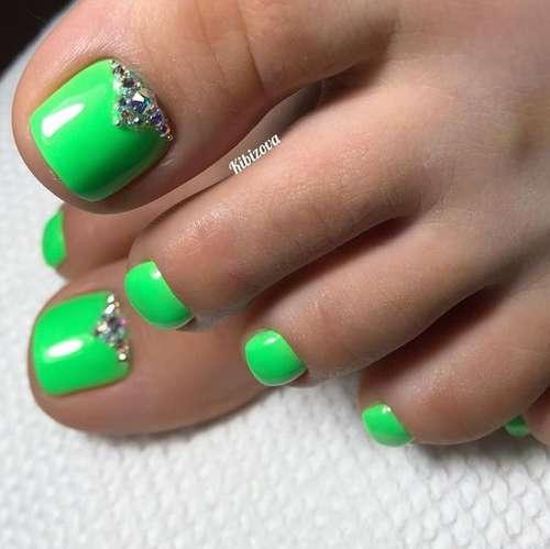 Green with rhinestones pedicure