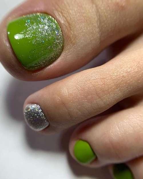 Green glitter pedicure