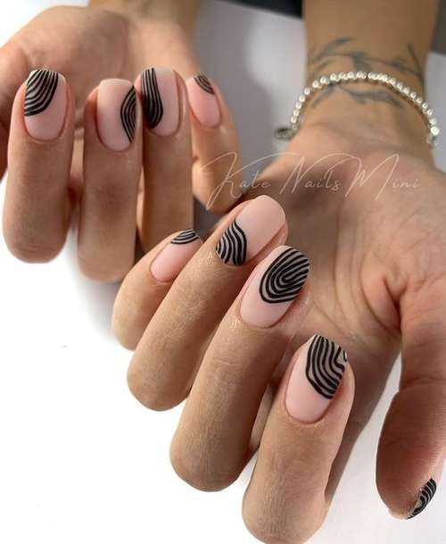 Beige manicure with black