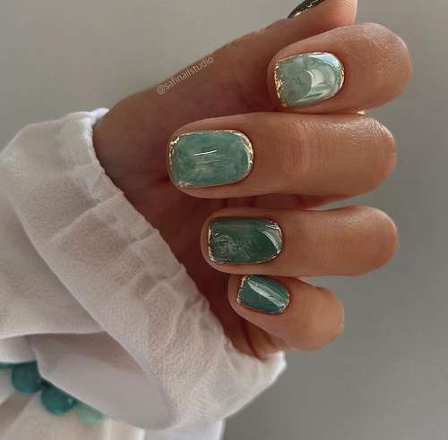 Green manicure with gold