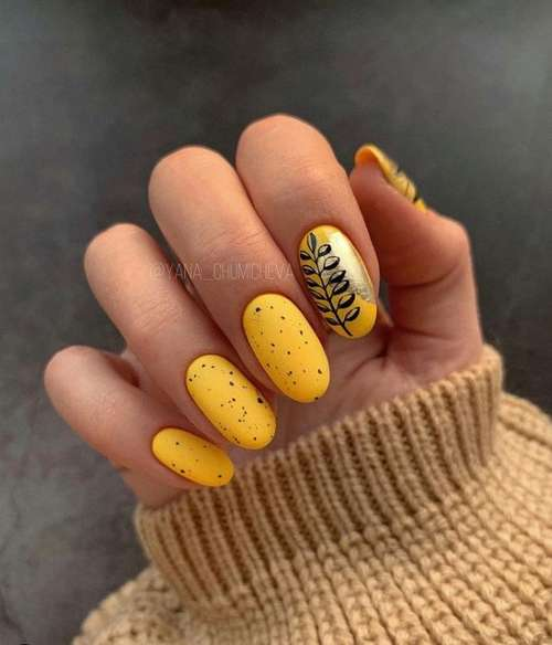 Yellow manicure with gold